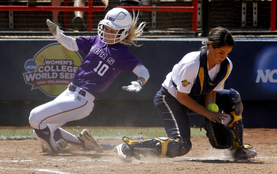 LSU's Ashley Applegate scores past California's Victoria Jones in the second inning of a Women's College World Series game at ASA Hall of Fame Stadium in Oklahoma City, Thursday, May 31, 2012.  Photo by Bryan Terry, The Oklahoman
