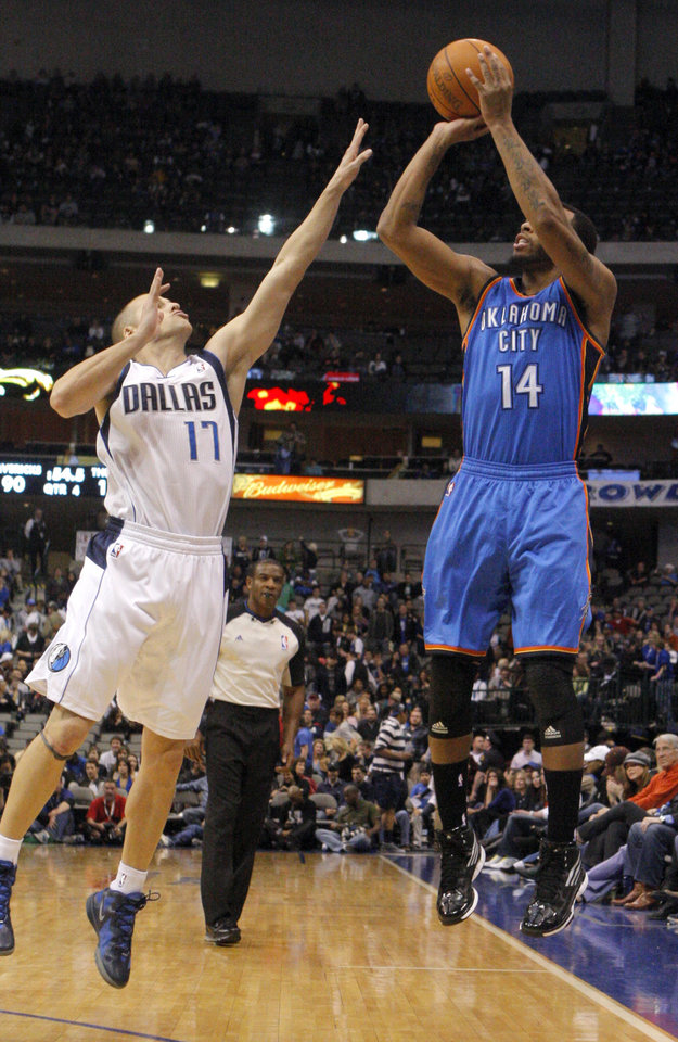 Oklahoma City's Daequan Cook (14) shoots as Dallas' Drew Neitzel during the pre season NBA game between the Dallas Mavericks and the Oklahoma City Thunder at the American Airlines Center in Dallas, Sunday, Dec. 18, 2011. Photo by Sarah Phipps, The Oklahoman
