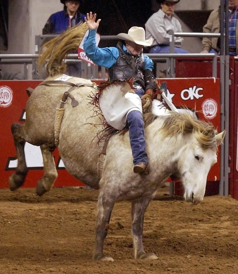 Cord McCoy, Tupelo, Okla., competes in the bareback riding during the International Finals Rodeo (IFR 33) at the Ford Center in Oklahoma City, Thursday, January 16, 2003. Staff photo by Nate Billings.