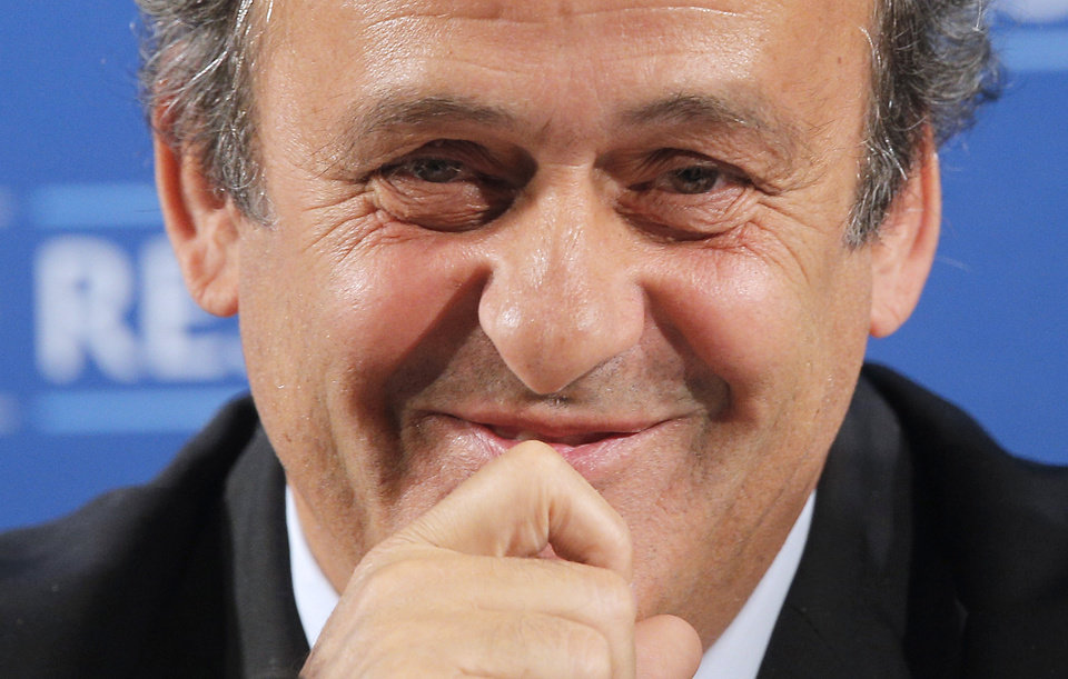 Photo - FILE - In this Feb.22, 2014 file photo, UEFA President Michel Platini gestures during a press conference, one day prior to the UEFA EURO 2016 qualifying draw in Nice, southeastern France. Michel Platini will not challenge Sepp Blatter for the FIFA presidency, saying Thursday Aug.28, 2014  there was