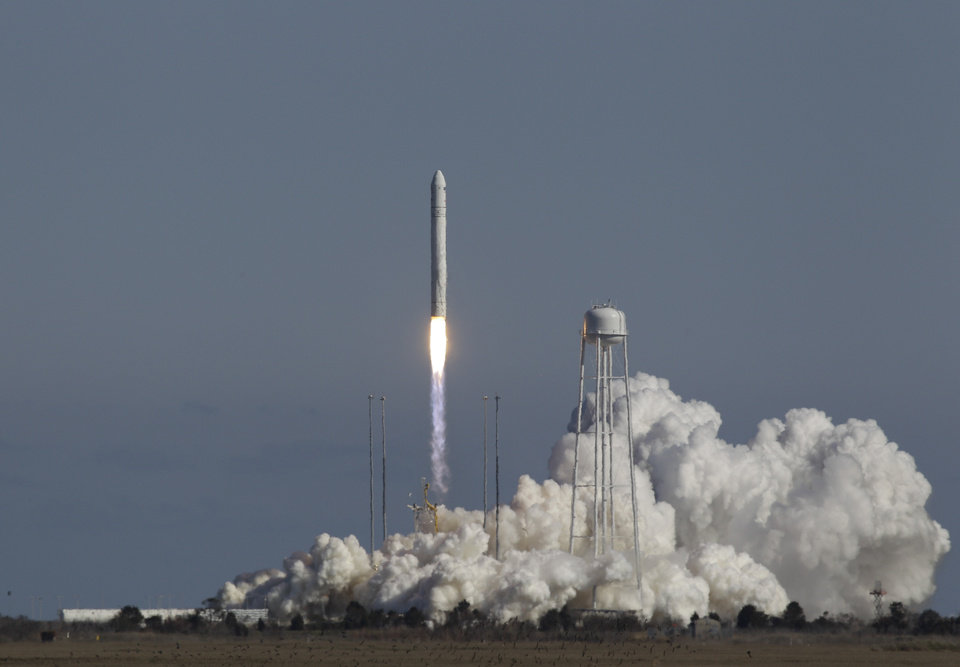 Photo - Orbital Sciences Corp.'s Antares rocket lifts off from the launchpad at the NASA facility on Wallops Island Va., Sunday April 21, 2013.  The rocket will eventually deliver supplies to the International Space Station.  (AP Photo/Steve Helber)