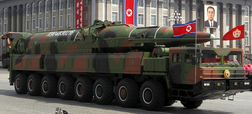 Photo -   In this photo taken Sunday, April 15, 2012, what appears to be a new missile is carried during a mass military parade at the Kim Il Sung Square in Pyongyang, North Korea, to celebrate the 100th anniversary of the country's founding father Kim Il Sung. The photo of the missile shows the warhead's surface is undulated, suggesting it's a thin metal sheet unable to withstand flight pressure, analysts say. Adding more doubt to North Korea's claims of military prowess after its flamboyant rocket launch failure, analysts say the half dozen missiles showcased at the military parade were low-quality fakes. (AP Photo/Ng Han Guan)