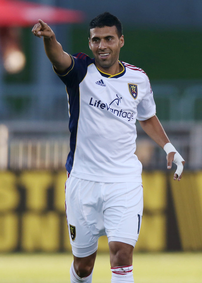 Photo - Real Salt Lake midfielder Javier Morales celebrates after his goal against the Colorado Rapids in the first half of an MLS soccer game in Commerce City, Colo., on Saturday, Aug. 2, 2014. (AP Photo/David Zalubowski)