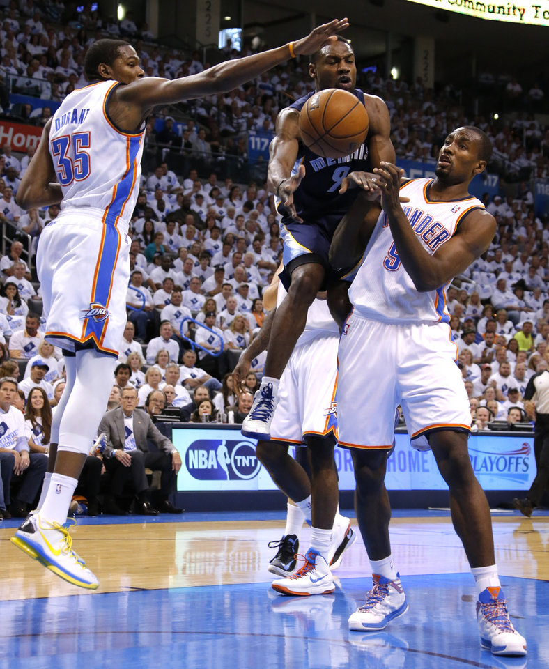 Tony Allen of Memphis goes between Oklahoma City's Kevin Durant and Serge Ibaka during Game 5 in the second round of the NBA playoffs between the Oklahoma City Thunder and the Memphis Grizzlies at Chesapeake Energy Arena In Oklahoma City, Wednesday, May 15, 2013. Photo by Bryan Terry, The Oklahoman