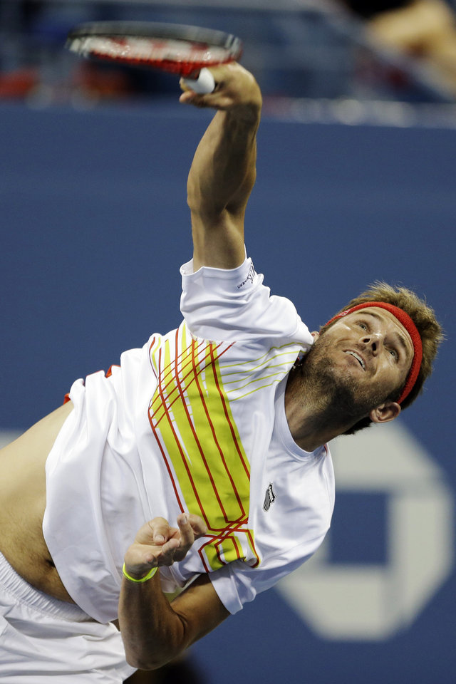 Photo -   Mardy Fish serves to Gilles Simon, of France, during a match at the U.S. Open tennis tournament Saturday, Sept. 1, 2012 in New York. (AP Photo/Darron Cummings)
