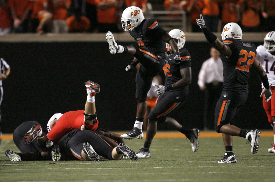 Oklahoma State's Daytawion Lowe (8) and James Thomas (22) celebrate a fumble recovery during the first half Thursday. PHOTO BY SARAH PHIPPS, The Oklahoman
