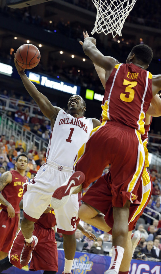 Photo - Oklahoma's Sam Grooms (1) shoots a lay up as Iowa State's Melvin Ejim (3) defends during the Phillips 66 Big 12 Men's basketball championship tournament game between the University of Oklahoma and Iowa State at the Sprint Center in Kansas City, Thursday, March 14, 2013. Photo by Sarah Phipps, The Oklahoman