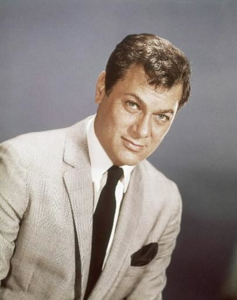 Actor  Tony  Curtis is shown, in this 1965 file photo.  Curtis  died Wednesday Sept. 29, 2010 at his Las Vegas area home of a cardiac arrest at 85 according to the Clark County, Nev. coroner. (AP Photo, File)