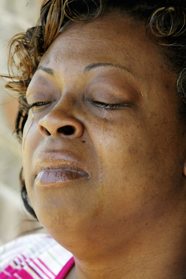 Photo - Cleta Jennings, Antwun Parker's mother, closes her eyes and leans her head back while talking about Antwun on her sister's front porch in Oklahoma City Friday, May 29, 2009. Parker, 16, was killed by pharmacist Jerome Jay Ersland during an attempted robbery of Reliable Discount Pharmacy, 5900 S Pennsylvania Ave, on May 19, 2009. Photo by Paul B. Southerland, The Oklahoman