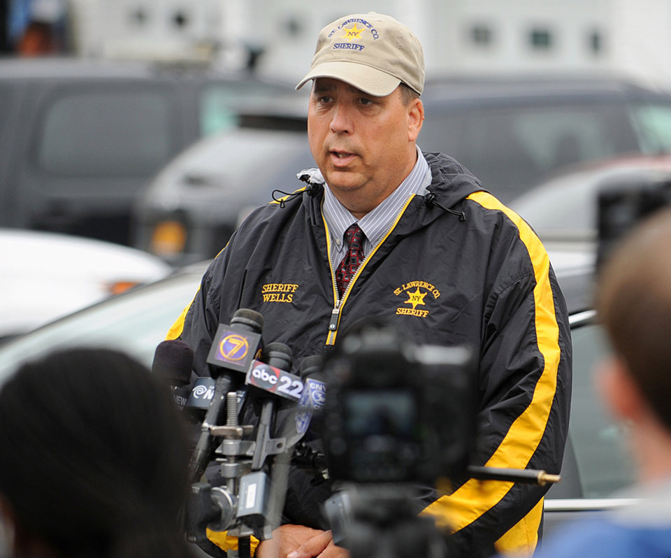 Photo - FILE - St. Lawrence County Sheriff Kevin M. Wells briefs the media on Friday, Aug. 15, 2014 in Heuvelton, N.Y., on the investigation into the abduction of two Amish sisters from the family's roadside vegetable stand on Wednesday, Aug. 13. Stephen Howells II, 39, and Nicole Vaisey, 25, both of Hermon, were each charged with two counts of first-degree kidnapping late Friday Aug. 15, 2014. They appeared in court with lawyers, but were not allowed to enter a plea. A town justice ordered them jailed without bond, and a preliminary hearing is scheduled for Thursday. (AP Photo/Watertown Daily Times, Jason Hunter, File) SYRACUSE OUT
