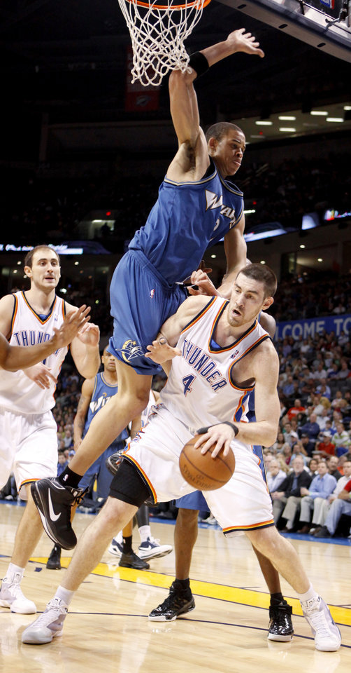 Oklahoma City\'s Nick Collison is fouled by JaVale McGee of Washington during the NBA basketball game between the Oklahoma City Thunder and the Washington Wizards at the Ford Center in Oklahoma City, Wed., March 4, 2009. PHOTO BY BRYAN TERRY, THE OKLAHOMAN