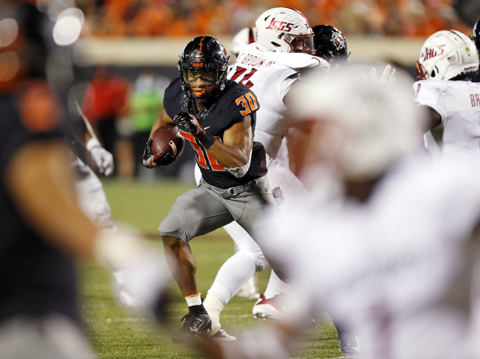 Photo - Oklahoma State's Chuba Hubbard (30) carries the ball in the fourth quarter during a college football game between Oklahoma State (OSU) and South Alabama at Boone Pickens Stadium in Stillwater, Okla., Saturday, Sept. 8, 2018. Photo by Nate Billings, The Oklahoman