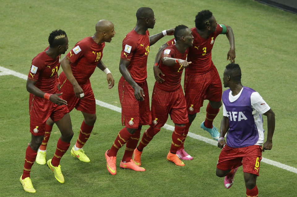 Photo - Ghana's Asamoah Gyan, second right, dances with his teammates as they celebrate after scoring their second goal during the group G World Cup soccer match between Germany and Ghana at the Arena Castelao in Fortaleza, Brazil, Saturday, June 21, 2014. (AP Photo/Themba Hadebe)