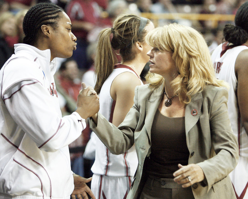 Amanda Thompson, left, and Sherri Coale shake hands after defeating Georgia Tech 69-50.  PHOTO BY STEVE SISNEY, THE OKLAHOMAN