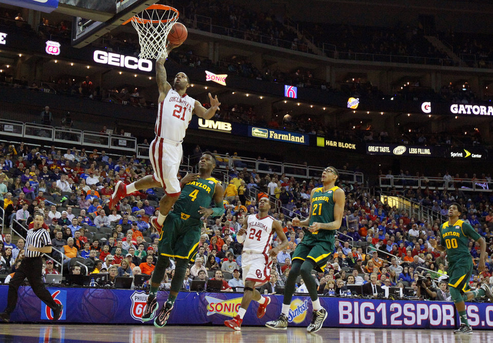 Photo - Oklahoma's Cameron Clark (21) dunks the ball in front of Baylor's Gary Franklin (4) during the Big 12 Tournament college basketball game between the University of Oklahoma and Baylor at the Sprint Center in Kansas City, Mo., Thursday, March 13, 2014. Baylor won 78-73.  Photo by Bryan Terry, The Oklahoman