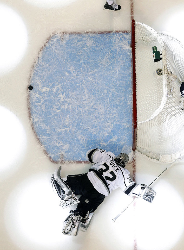 Los Angeles Kings goalie Jonathan Quick (32) lays on the ice after San Jose Sharks center Joe Thornton (19) scored a goal during the first period in Game 6 of their second-round NHL hockey Stanley Cup playoff series in San Jose, Calif., Sunday, May 26, 2013. (AP Photo/Tony Avelar)