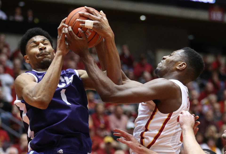 Photo - TCU center Karviar Shepherd (1) and Iowa State forward Melvin Ejim (3) vie for control of a rebound during the first half of an NCAA college basketball game at Hilton Coliseum in Ames, Iowa, Saturday, Feb. 8, 2014. (AP Photo/Justin Hayworth)