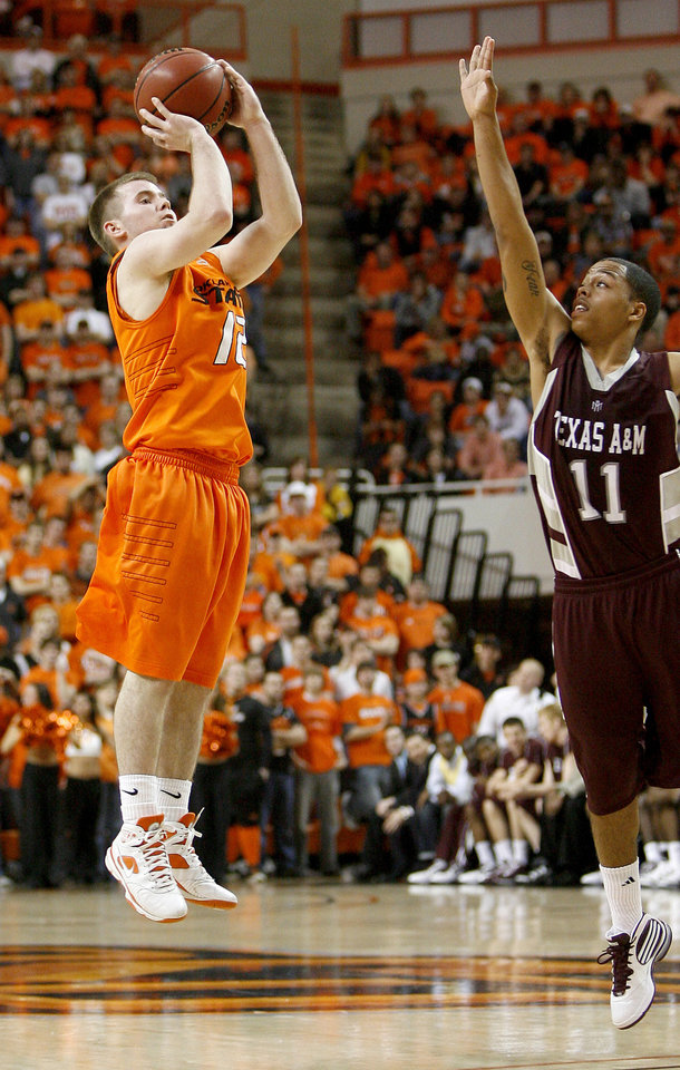 Photo - OSU' Keiton Page shoots a basket in front of Texas A&M's B.J. Holmes during an NCAA college basketball game between the Oklahoma State University and Texas A&M at Gallagher-Iba Arena in Stillwater, Okla., Wednesday, January 27, 2010. Photo by Bryan Terry, The Oklahoman