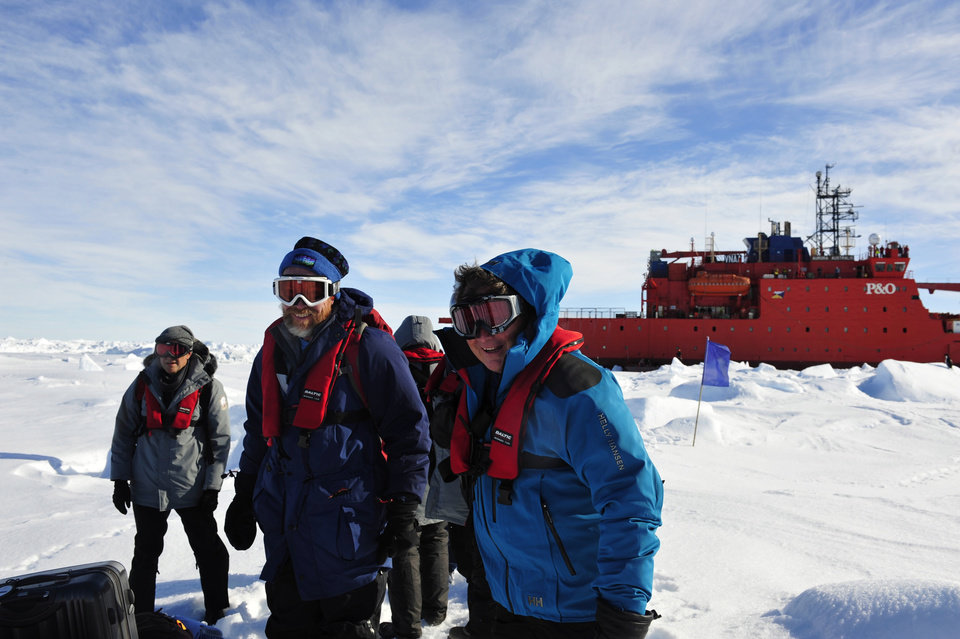Photo - In this photo provided China's official Xinhnua News Agency, the first group of passengers aboard the trapped Russian ship MV Akademik Shokalski arrive at a safe surface off the Antarctic Thursday, Jan. 2, 2014. A helicopter rescued all 52 passengers from the research ship that has been trapped in Antarctic ice, 1,500 nautical miles south of Hobart, Australia, since Christmas Eve after weather conditions finally cleared enough for the operation Thursday. (AP Photo/Xinhua, Zhang Jiansong) NO SALES