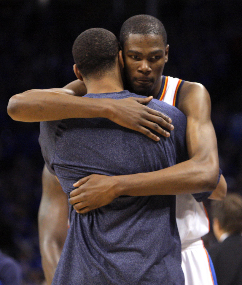Oklahoma City's Kevin Durant (35) hugs  Russell Westbrook (0) late in the fourth quarter during game 7 of the NBA basketball Western Conference semifinals between the Memphis Grizzlies and the Oklahoma City Thunder at the OKC Arena in Oklahoma City, Sunday, May 15, 2011. Photo by Sarah Phipps, The Oklahoman