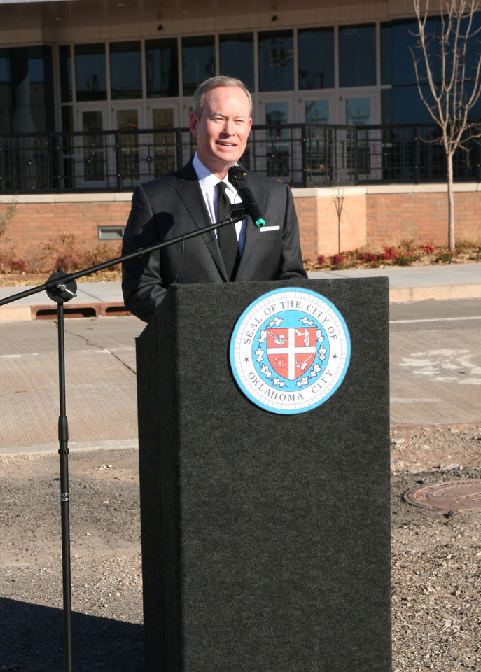 Photo - Oklahoma City Mayor Mick Cornett speaks Thursday in front of Chesapeake Energy Arena after it was announced he will receive a national urban design leadership award. Photo provided  PROVIDED