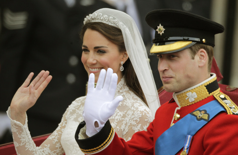 Photo - Britain's Prince William and his wife Kate, Duchess of Cambridge, left, wave as they leave Westminster Abbey at the Royal Wedding in London Friday, April 29, 2011. (AP Photo/Gero Breloer)  ORG XMIT: RWFO149