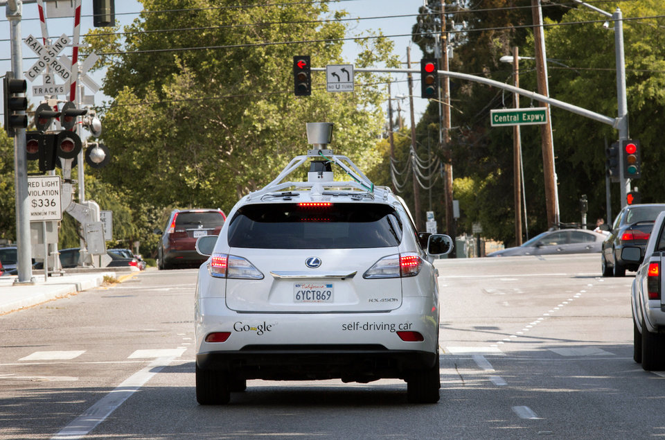 Photo - This Wednesday, April 23, 2014 photo provided by Google shows the Google driverless car navigating along a street in Mountain View, Calif. The director of Google's self-driving car project wrote in a blog post Monday, April 28, that development of the technology has entered a new stage: trying to master driving on city streets. Many times more complex than freeways, which the cars can now reliably navigate, city streets represent a huge challenge. (AP Photo/Google)