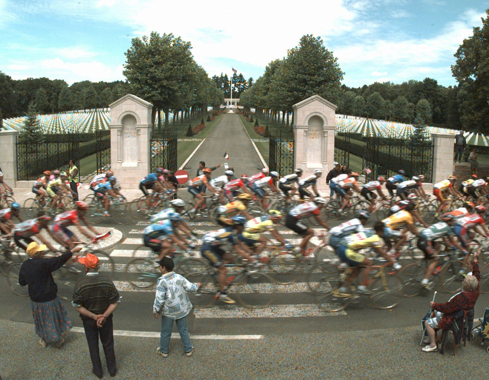 Photo - FILE - In this July 3, 1996 file photo, the pack rides past the Oise-Aisne American cemetery and memorial at Seringes-et-Nesles during the 4th stage of the Tour de France cycling race between Soissons and the Madine Lake, eastern France. The majority of the 6,012 War Dead interred in the cemetery died fighting along the Ourcq river and in nearby areas in 1918. (AP Photo/Laurent Rebours, File)