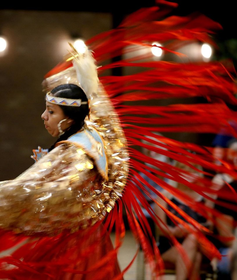 Photo - Courtney Reeder, who is Kiowa and Creek, performs a fancy shawl dance during a dance exhibition by the Central Plains Dancers at the Red Earth Festival at Grand Event Center at the Grand Casino Hotel & Resort, Saturday, Sept. 5, 2020. [Bryan Terry/The Oklahoman Archives]