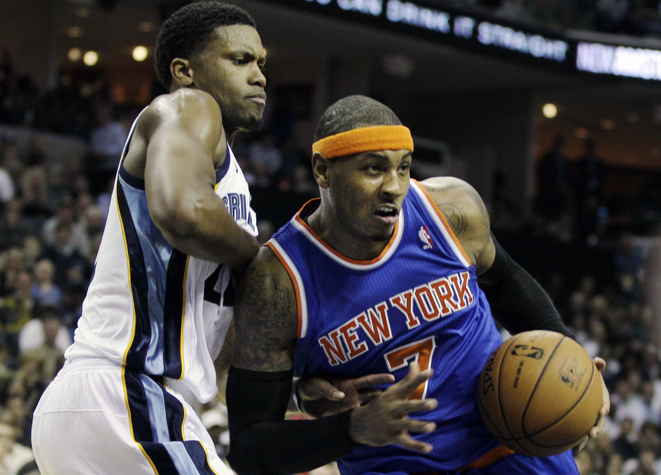 Photo -   New York Knicks' Carmelo Anthony (7) pushes past Memphis Grizzlies' Rudy Gay during the first half of an NBA basketball game in Memphis, Tenn., Friday, Nov. 16, 2012. (AP Photo/Danny Johnston)