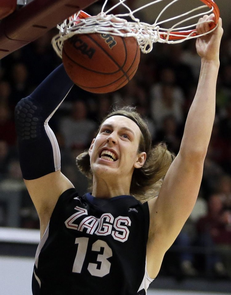 Photo - FILE - In this Jan. 5, 2013 file photo, Gonzaga's Kelly Olynyk scores against Santa Clara in the first half of an NCAA college basketball game in Santa Clara, Calif.  Olynyk is a possible first round pick in the NBA Draft on June 27.  (AP Photo/Ben Margot, File)