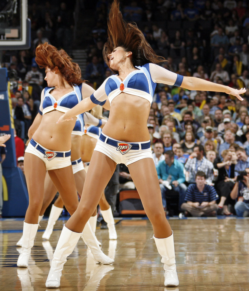 Photo - The Thunder Girls dance team performs during an NBA basketball game between the Oklahoma  City Thunder and the Detroit Pistons at the OKC Arena in Oklahoma City, Friday, March 11, 2011. Photo by Nate Billings, The Oklahoman