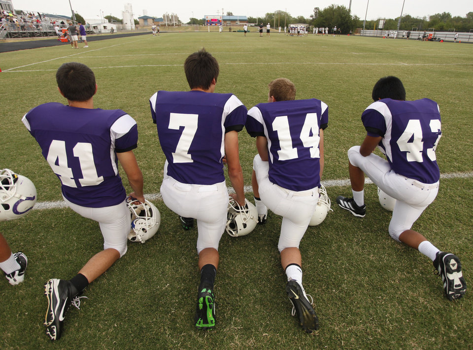 Photo - Bethany players wait their turn during a high school football scrimmage between Bethany and Jones at Bethany Bronco Stadium, Thursday, August 22, 2012. Photo by Doug Hoke, The Oklahoman.