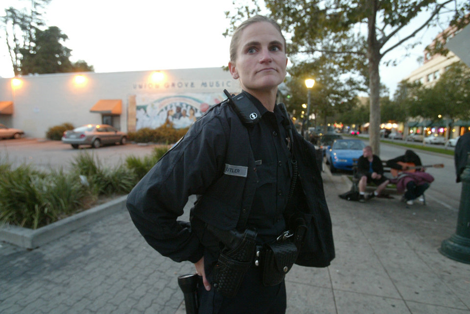 In this 2005 photo, Santa Cruz police officer Elizabeth Butler patrols along Pacific Avenue in Santa Cruz, Calif. Butler was one of the two detectives who were killed while responding to a sexual assault report Tuesday afternoon, Feb. 26, 2013, at the doorstep of a suspect who was chased down and killed half an hour later. (AP Photo/Santa Cruz Sentinel, Shmuel Thaler)