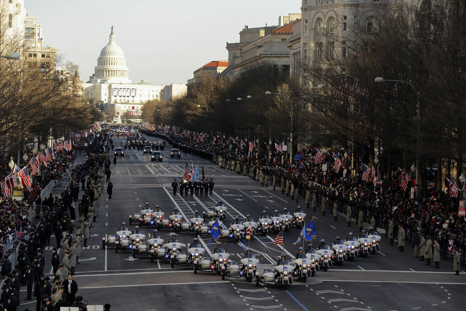 Photo - The 57th Presidential Inaugural Parade rolls down Pennsylvania Avenue from Capitol Hill in Washington, Monday,Jan. 21,2013, following President Barack Obama's ceremonial swearing-in ceremony during the 57th Presidential Inauguration. (AP Photo/Alex Brandon)