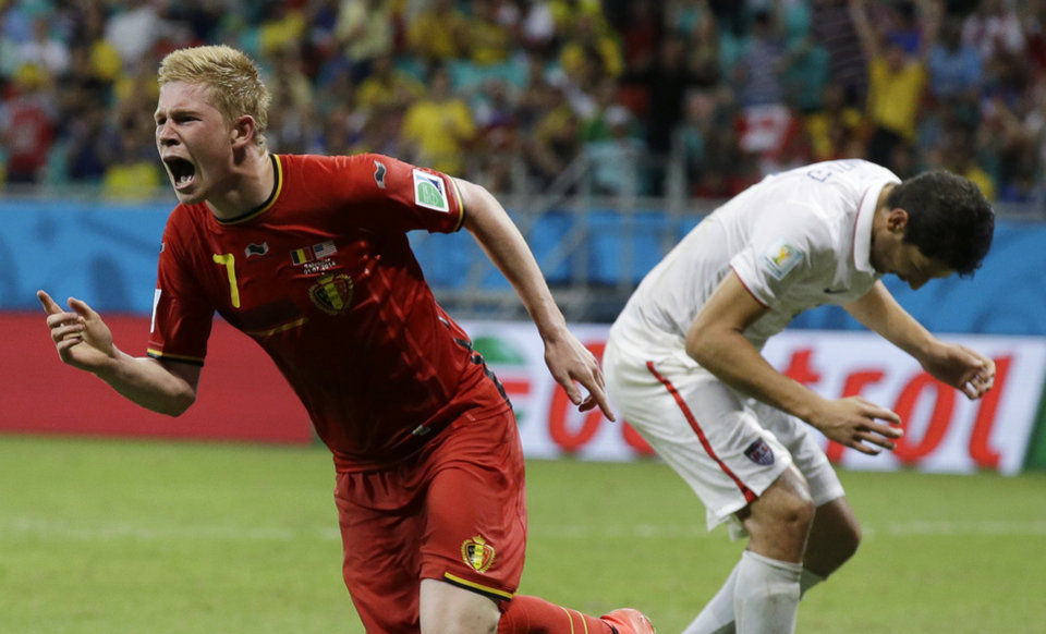 Photo - Belgium's Kevin De Bruyne celebrates after scoring the opening goal during the World Cup round of 16 soccer match between Belgium and the USA at the Arena Fonte Nova in Salvador, Brazil, Tuesday, July 1, 2014. (AP Photo/Matt Dunham)