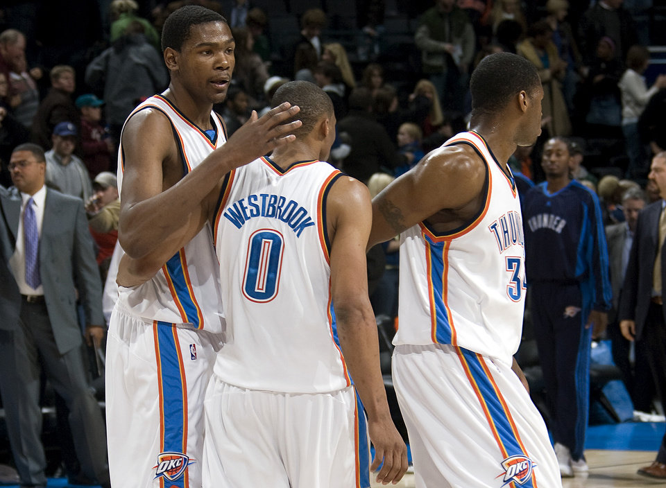 Photo - NBA BASKETBALL GAME / REACTION: Oklahoma City's Kevin Durant, Russell Westbrook and Desmond Mason react after losing the Cleveland Cavaliers, Sunday, Dec. 21, 2008, at the Ford Center in Oklahoma City. PHOTO BY SARAH PHIPPS, THE OKLAHOMAN ORG XMIT: KOD