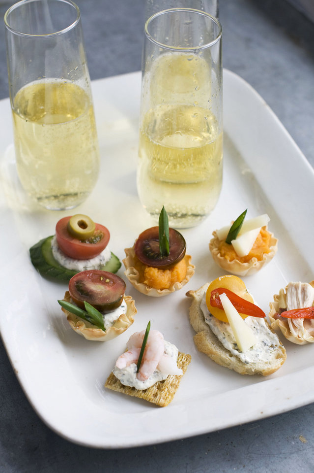 Using our building block approach to Oscar party canapes, diners are able to select from a buffet of ingredients — from bases and spreads to toppings and garnishes — to design snacks that suit their preferences as shown on this serving tray. AP Photo