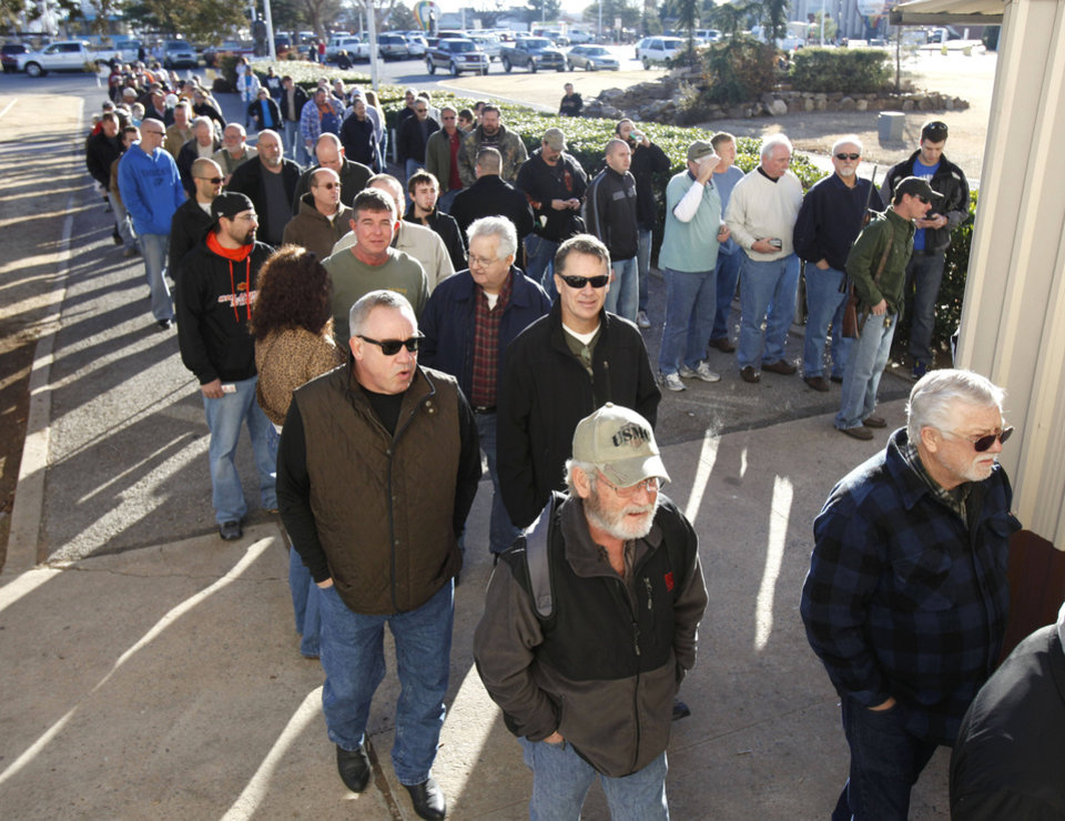Gun enthusiasts line up outside the Expo Hall at State Fair Park in Oklahoma City, OK, to attend a gun show, Saturday, January 19, 2013,  By Paul Hellstern, The Oklahoman