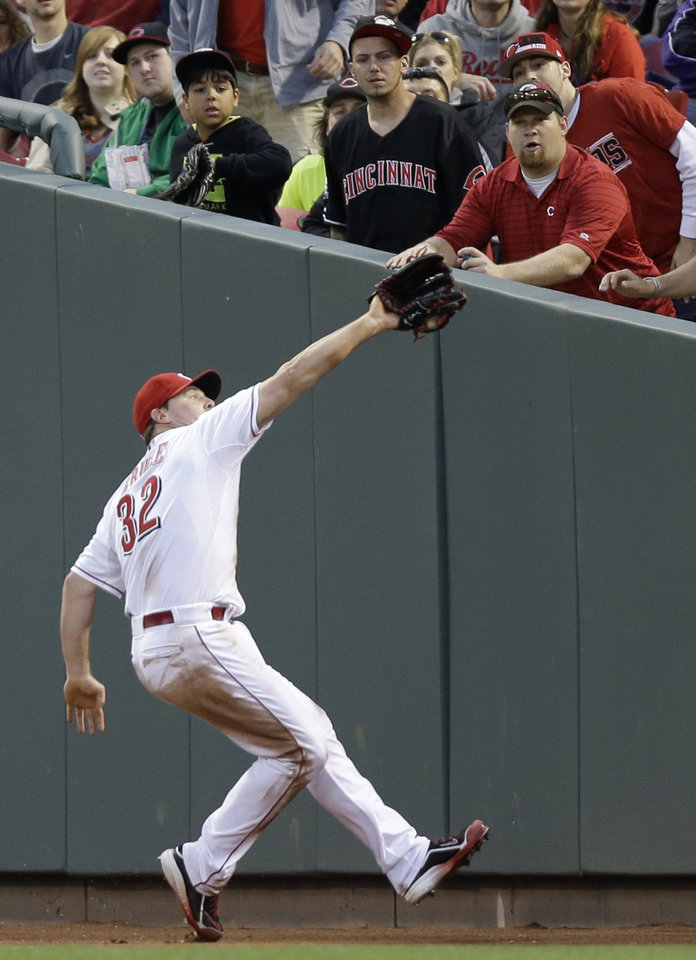 Photo - Cincinnati Reds right fielder Jay Bruce catches a foul ball hit by Chicago Cubs' Emilio Bonifacio in the fourth inning of a baseball game o Wednesday, April 30, 2014, in Cincinnati. (AP Photo)