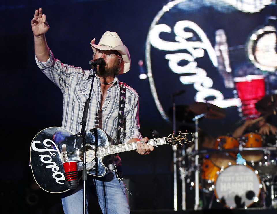 Photo - Toby Keith performs during the Oklahoma Twister Relief Concert, benefiting victims of the May tornadoes, at Gaylord Family - Oklahoma Memorial Stadium on the campus of the University of Oklahoma in Norman, Okla., Saturday, July 6, 2013. Photo by Nate Billings, The Oklahoman