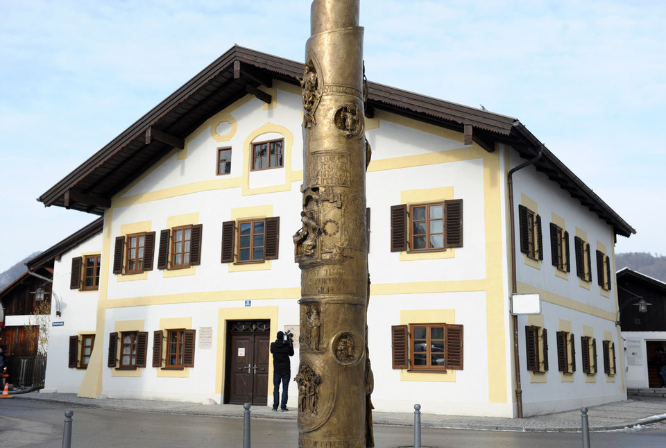 A man takes pictures of the birth place of Pope Benedict XVI in the German village of Marktl am Inn, southern Germany, Monday Feb. 11, 2013. In front the 'Benedikt Column'. Pope Benedict XVI said Monday he lacks the strength to fulfill his duties and on Feb. 28 will become the first pontiff in 600 years to resign. The announcement sets the stage for a conclave in March to elect a new leader for world's 1 billion Catholics.  (AP Photo/dpa,Andreas Gebert)
