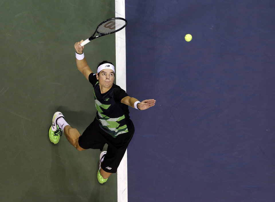 Milos Raonic, of Canada, serves to Denis Istomin, of Uzbekistan, during the SAP Open tennis tournament in San Jose, Calif., Friday Feb. 15, 2013. (AP Photo/Marcio Jose Sanchez)