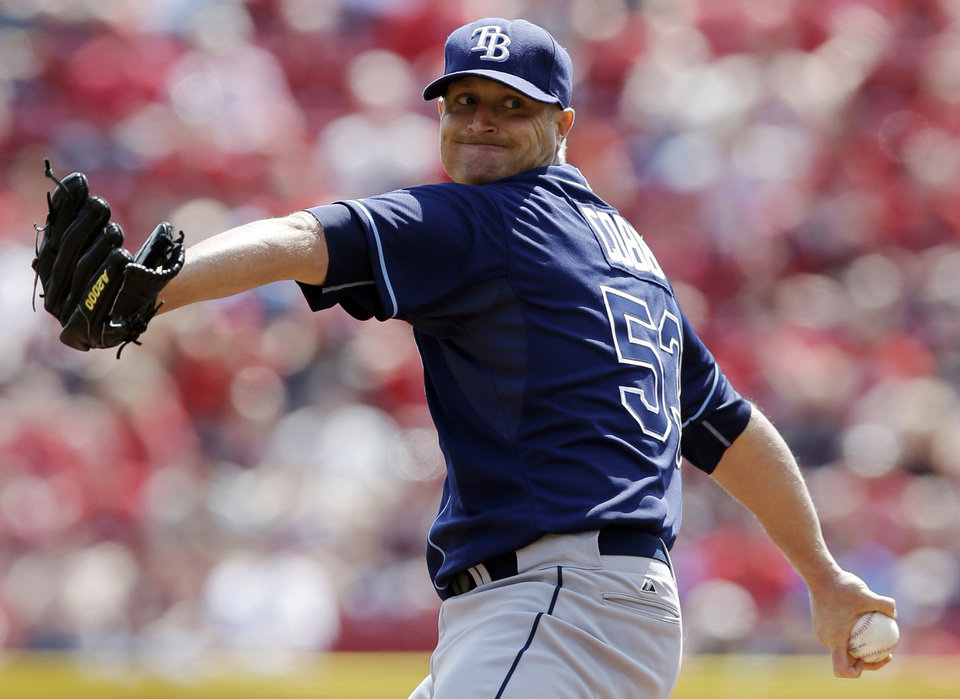 Photo - Tampa Bay Rays starting pitcher Alex Cobb throws against the Cincinnati Reds in the first inning of a baseball game, Saturday, April 12, 2014, in Cincinnati. (AP Photo/Al Behrman)