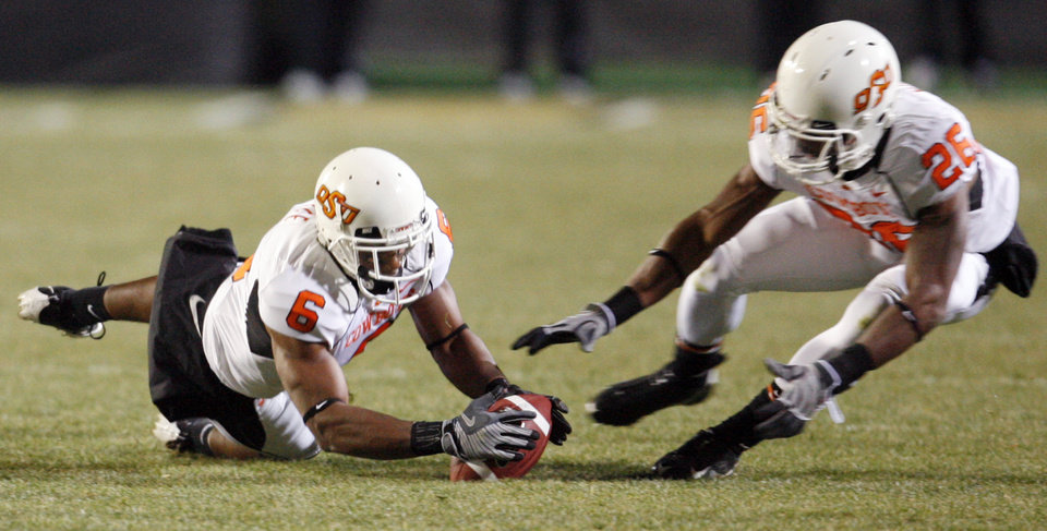 Photo - OSU's Ricky Price (6) recovers a Colorado fumble next to Quinton Moore (26) in the first quarter during the college football game between Oklahoma State University and University of Colorado at Folsom Field in Boulder, Colo., Saturday, Nov. 15, 2008. BY NATE BILLINGS, THE OKLAHOMAN