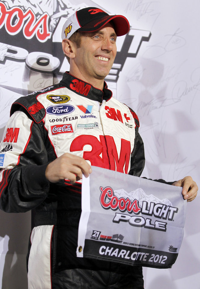 Photo -   Greg Biffle poses for photos after winning the pole position for Saturday's NASCAR Bank of America 500 Sprint Cup series auto race during qualifying in Concord, N.C., Thursday, Oct. 11, 2012. (AP Photo/Terry Renna)