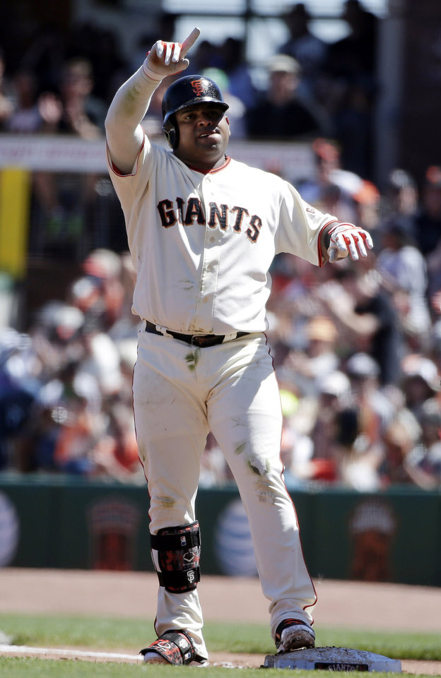 Photo - San Francisco Giants' Pablo Sandoval gestures to the dugout after driving in two runs with a single against the Milwaukee Brewers during the third inning of a baseball game on Sunday, Aug. 31, 2014, in San Francisco. (AP Photo/Marcio Jose Sanchez)