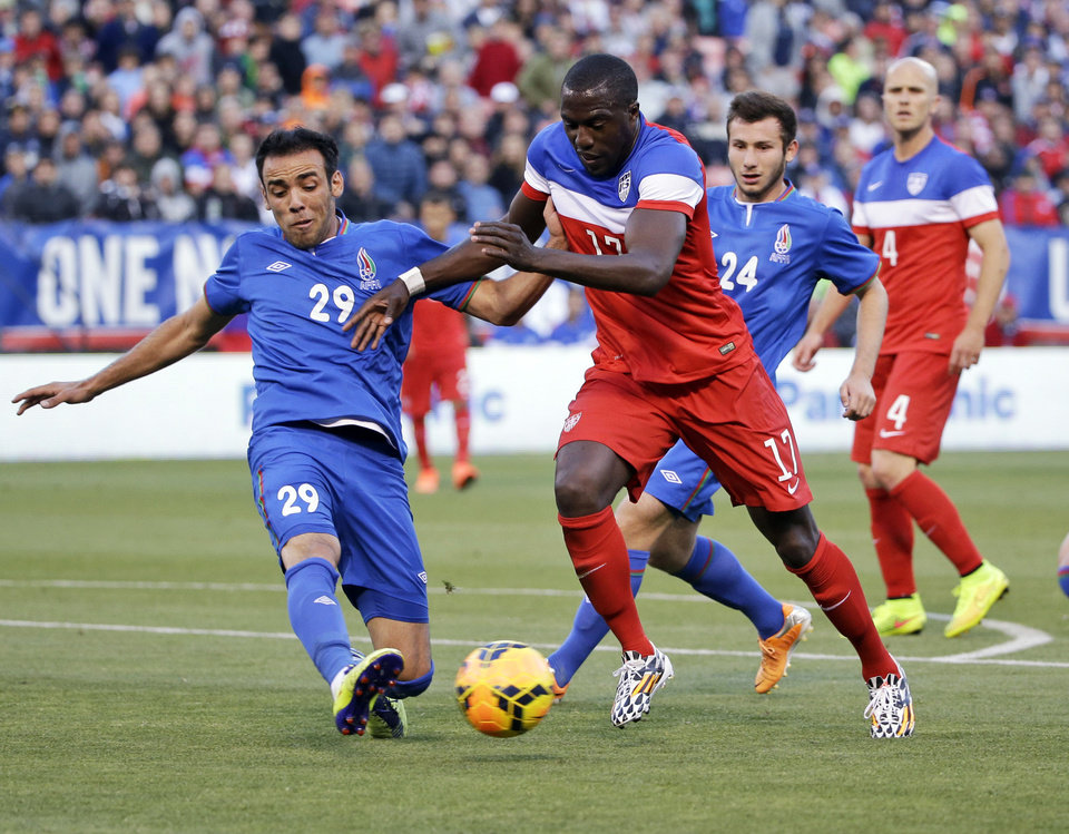 Photo - United States' Jozy Altidore (17) tries to dribble around Azerbaijan's Elvin Yunuszade (29) during the first half of an international friendly soccer match on Tuesday, May 27, 2014, in San Francisco. (AP Photo/Marcio Jose Sanchez)