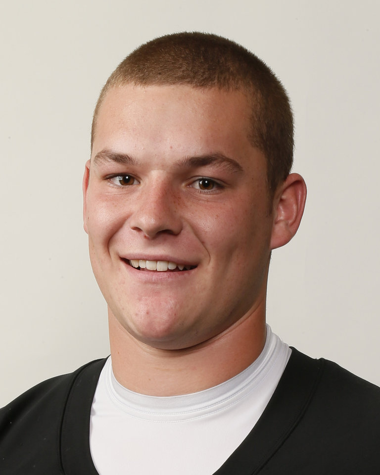 Photo - Jaxon Uhles, Norman North football player, poses for a mug shot during The Oklahoman's Fall High School Sports Photo Day in Oklahoma City, Wednesday, Aug. 15, 2012. Photo by Nate Billings, The Oklahoman