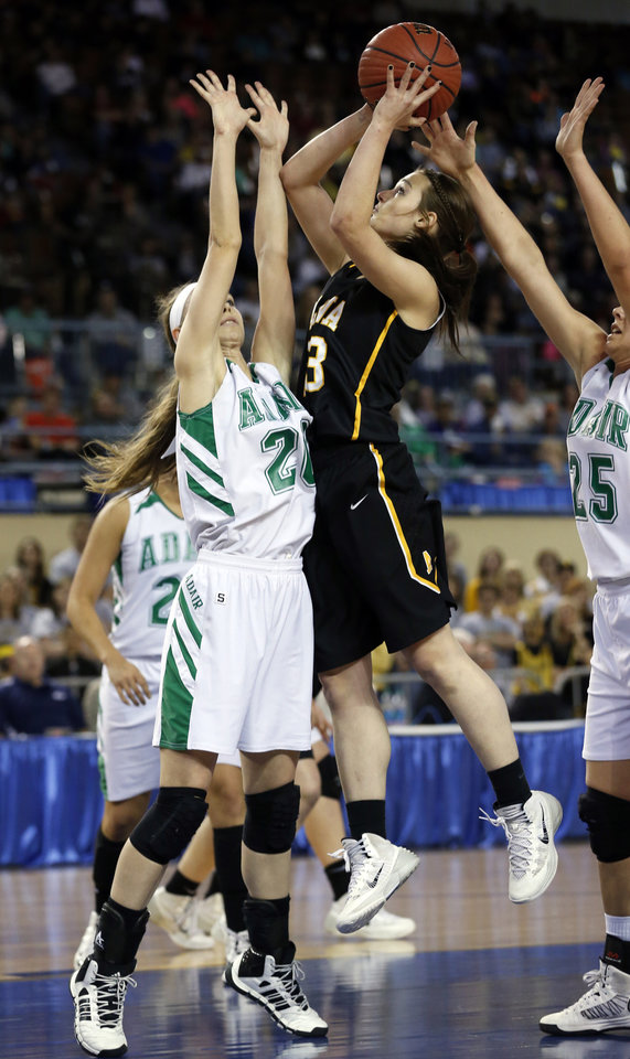 Photo - Alba's Jaden Hobbs shoots over Bailey Stephens as the Adair Lady Warriors play the Alva Lady Goldbugs in the finals of the State Class 3A Girls Basketball Tournament at the Fairgrounds Arena on Saturday, March 15, 2014, in Oklahoma City, Okla. Photo by Steve Sisney, The Oklahoman